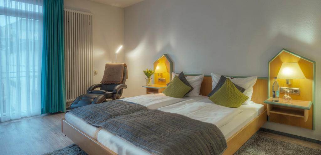 Doppelzimmer mit Relaxsessel